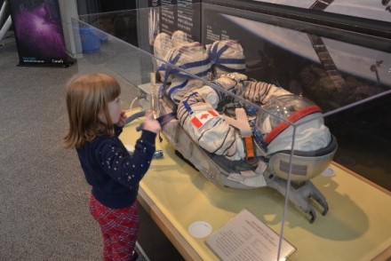 Six-Year-Old Abigail Enthralled By Canadian Astronaut Chris Hadfield's Sokol spacesuit