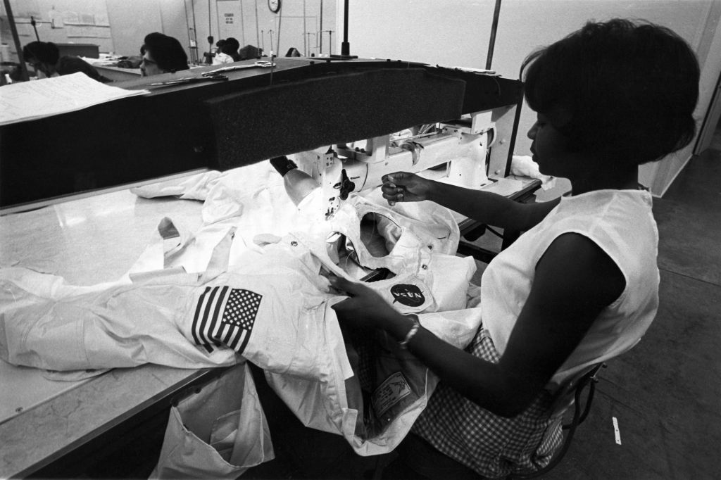 Seamstress Hazel Fellows sewing the thermal micrometeoroid garment of the ILC A7L Apollo spacesuit( [Quartz/Copyright, ILC Dover]