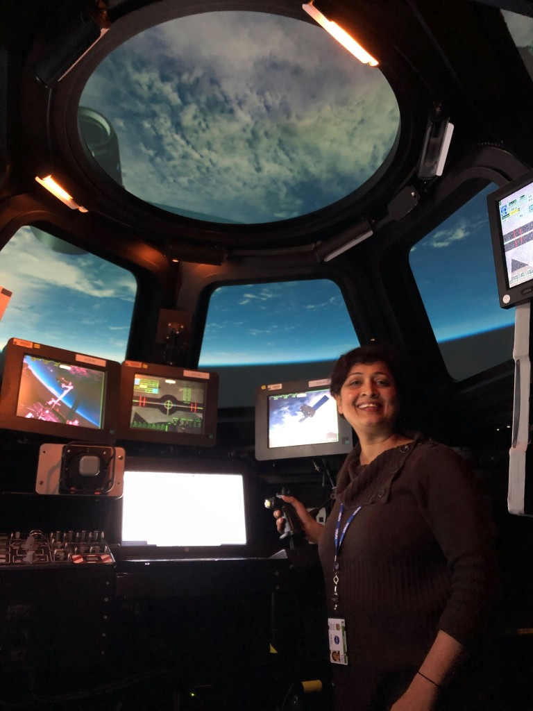 Anima Patil-Sabale working at NASA's Johnson Spaceflight Center in the ISS cupola module mock-up simulation lab -astronauts train in this lab to prepare for ISS missions [Anima Patil-Sabale]