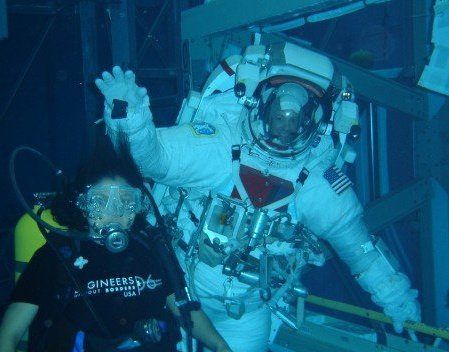 Madhurita with astronaut Ron Garan during a training session to practice a spacewalk in the Neutral Buoyancy Laboratory (NBL)