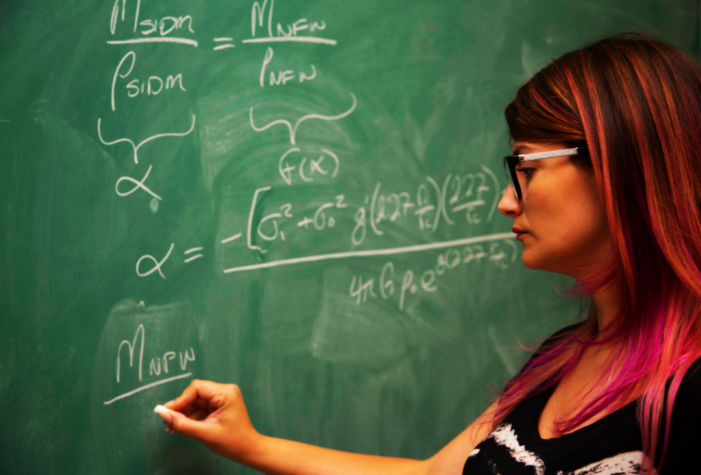 Sophia Nasr working out equations for her dark matter research