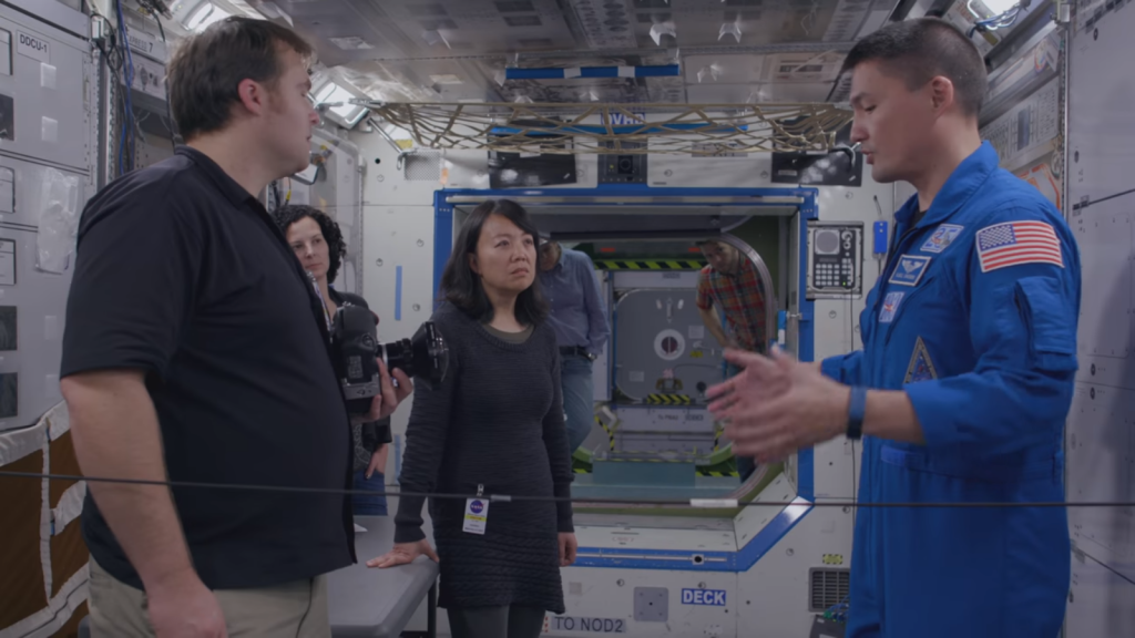 The Google Street View and ThinkSpace Consulting team discussing their mapping method with NASA Astronaut Kjell Lindgren