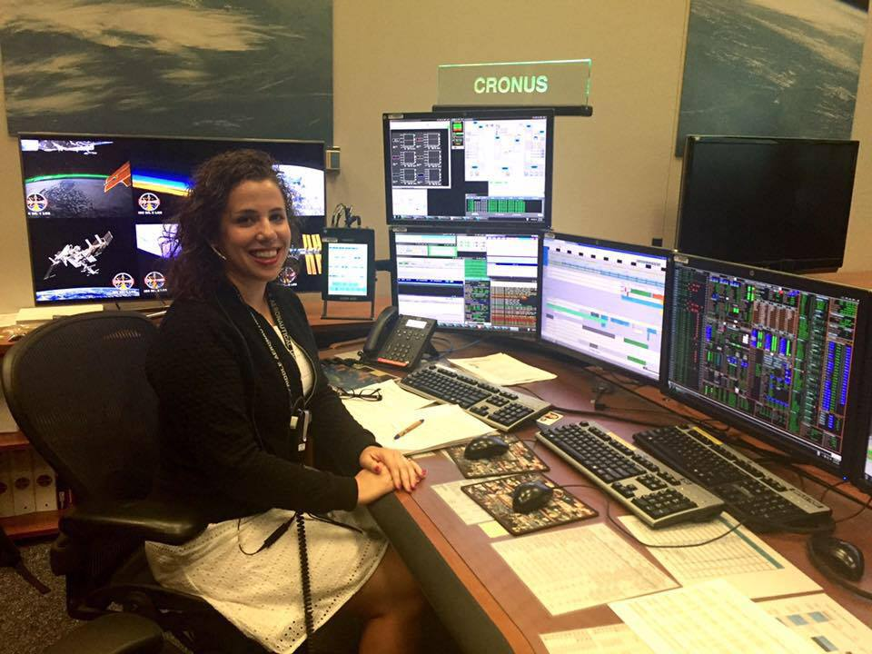 Natalie Gogins working in NASA Mission Control Center at the CRONUS Console