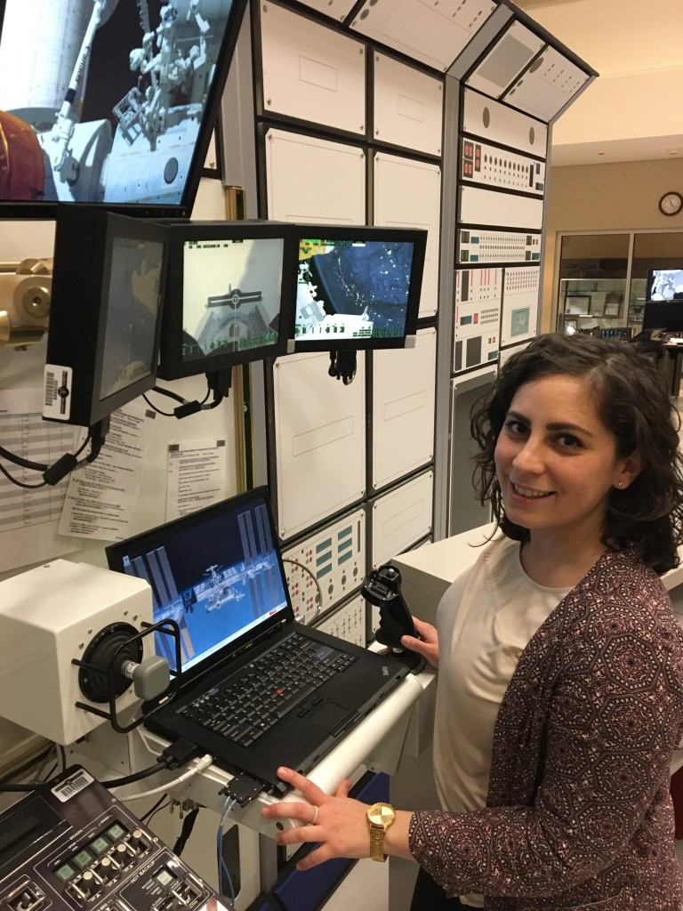 Kristen Facciol simulating Canadarm operations on-ground