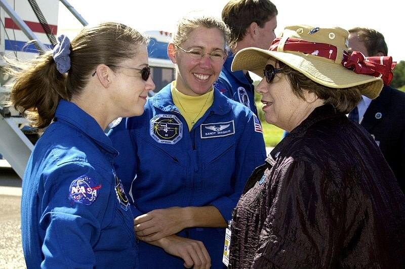 STS-112 Pilot Pamela Melroy (left) and Mission Specialist Sandra Magnus (center) talk to Acting Deputy Director JoAnn Morgan (right) after the crew's return to KSC. Credit: NASA