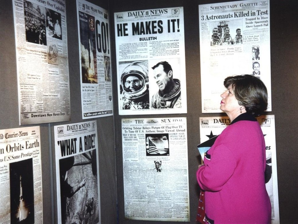 JoAnn Morgan studies posters of space-related news stories in the mobile exhibition when she was the associate director for Advanced Development and Shuttle Upgrades at KSC. Credit: NASA [3].
